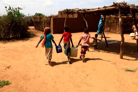 Children fetch water in Sudan. Photograph by Mohammed Noureldin
