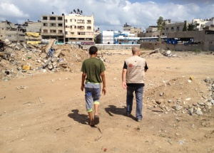 CAFOD partners inspecting damaged land and buildings in Gaza (Photo: Caritas Jerusalem)