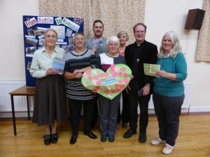 Members of the Settle churches diplaying the giant heart with their pledges on