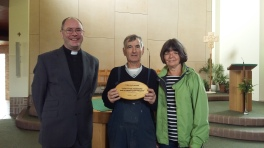 Fr. Gerard and parishioners Trish and David with their award. (3)
